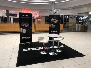 promotional stand at westgate mall ,where showmax had a logo mat with their brand image
