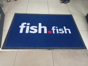 custom branded mat placed on the floor of a food take away shop