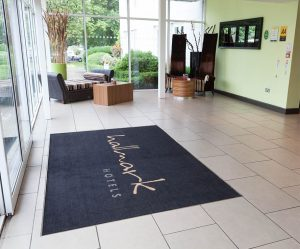hallmark hotels promotional mat placed in front of the hotel entrance